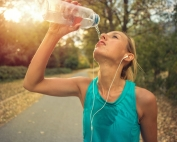 beautiful-and-sporty-young-woman-drinking-water-royalty-free-image-1589560195